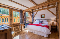 Alpine chalet bedroom with restore beams & picture windows